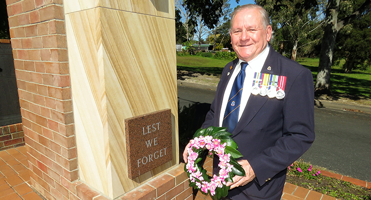 A Time To Remember: Veteran Peter Millen lays a wreath in remembrance of the lives lost and sacrifices made.