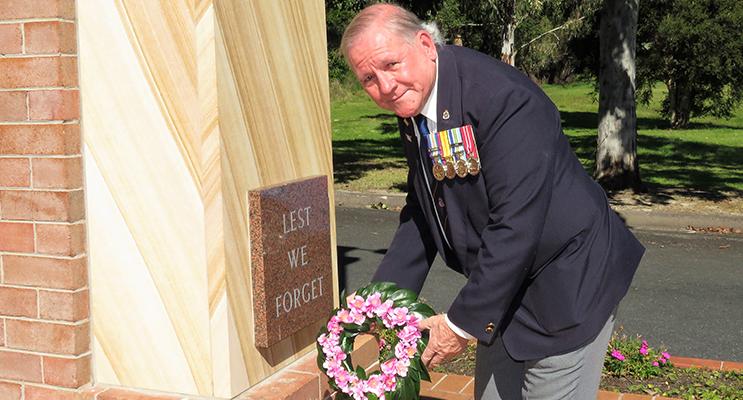 Vietnam Veteran, Peter Millen, lays a wreath in remembrance.