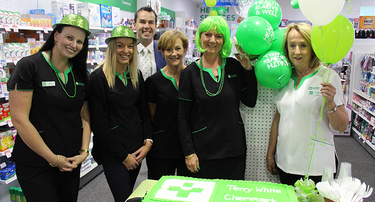 Tomaree Business Chamber president Ryan Palmer with part owners Sue Milne and Scott Elsegood. Pic 1: Ryan Palmer, Sue Milne and staff cutting the cake.