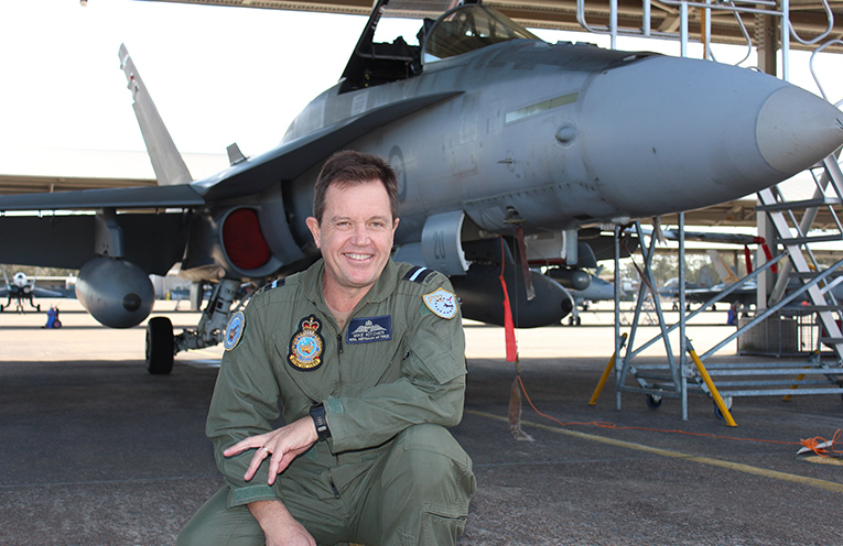Air Commodore Mike Kitcher in front of an F-A/18 Hornet at Williamtown.