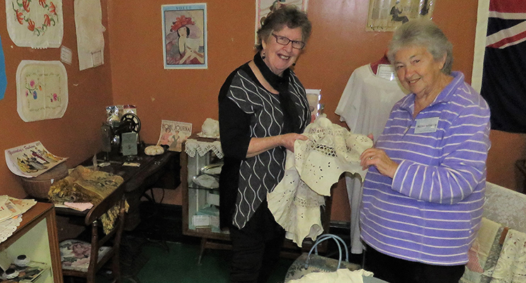 Diane Burns and Irene Worth in the sewing corner at the Courthouse Museum.