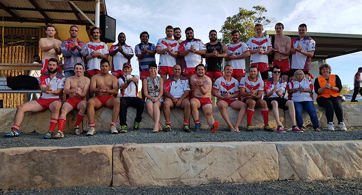 KARUAH SPORTS OVAL: Kate Washington MP front and centre with the Karuah Roos Rugby League Team.