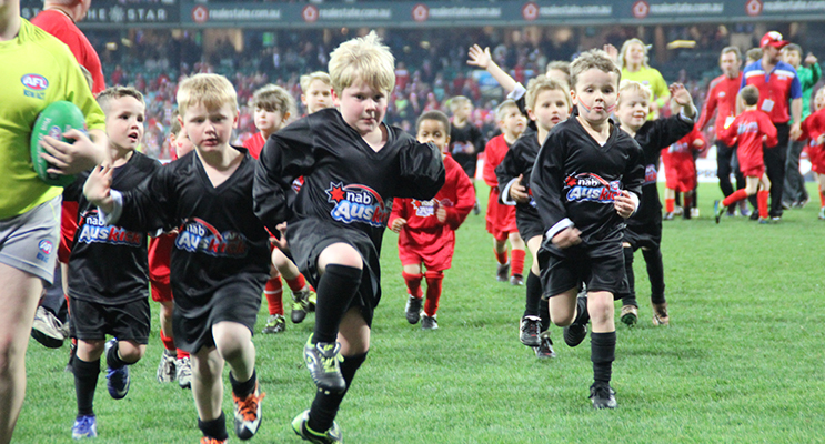 Talan Fleming, Tyson Hay, Dane McKimm and Ben Campbell run out with their team mates.
