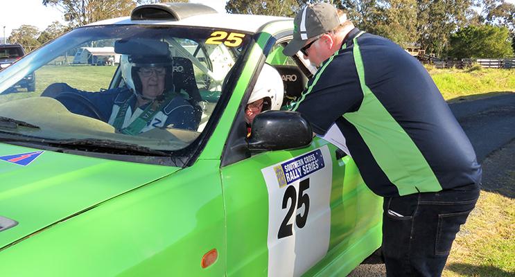AMSAG official Jamie Neale instructs Mitsubishi driver John Fraser and navigator John Paine at Bulahdelah Showground.