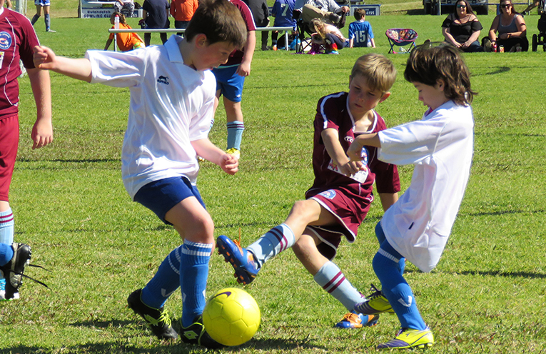 Stepping Up: Junior players show their skills on the field.