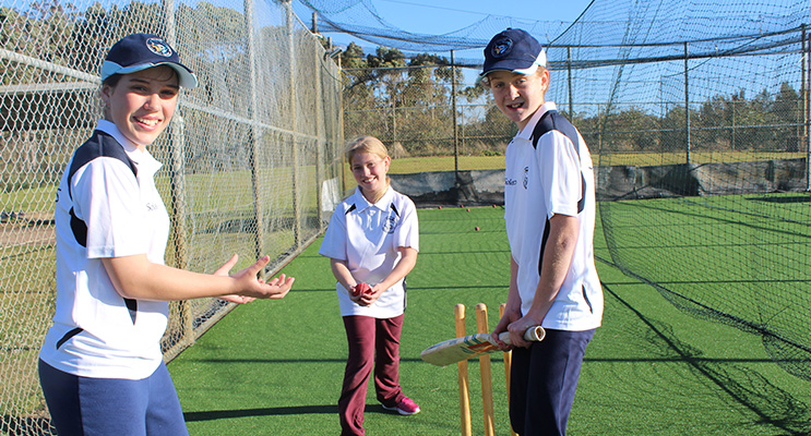 Cricketers Lillee Banks, 11, Chelsea Brealey, 10 and Aili Martin, 12, in the practice nets.
