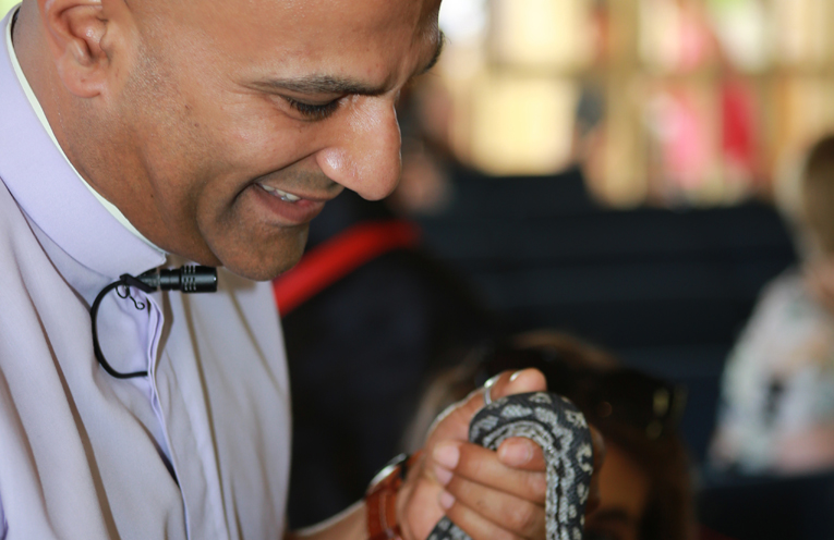 Rev Kesh blessing a snake at the Annual Blessing of the Animals.