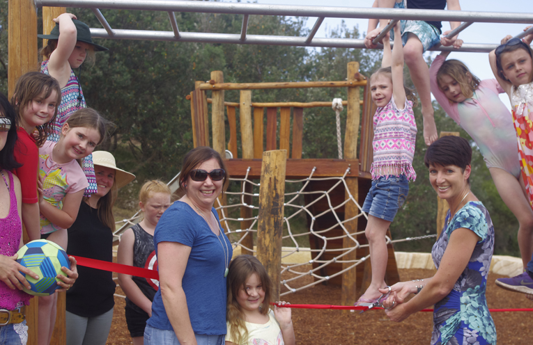 Port Stephens Member Of Parliament Kate Washington Officially Opening the Boat Harbour Playground with a group of local children enjoying the monkey bars.