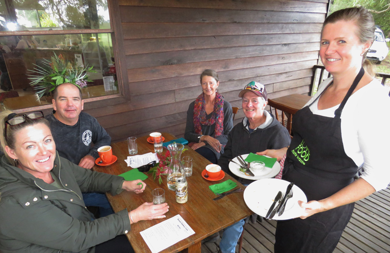 Cafe Volunteer Megan Griffiths serves Sandy and Ricky Woods and Helen and Allen Gorman.