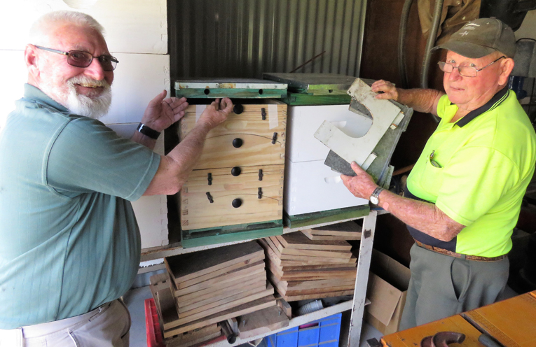 Steve Newman and John Renfrew working on the bee boxes.