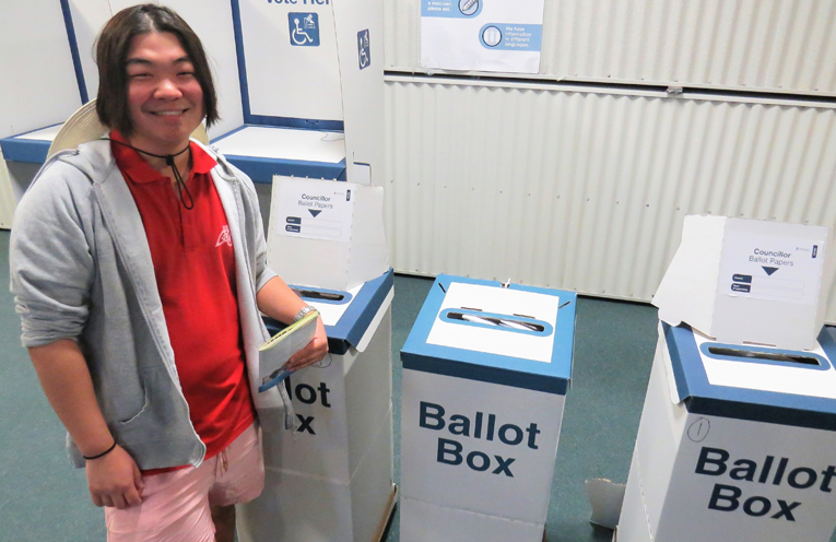 First-time voter Tim To casts his ballot in Tea Gardens.