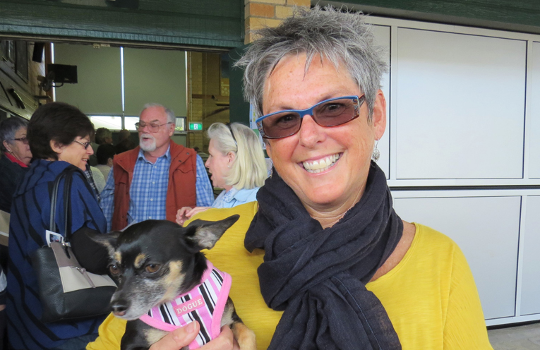 Liz McKay arrived to cast her vote in Tea Gardens with her dog Bella.