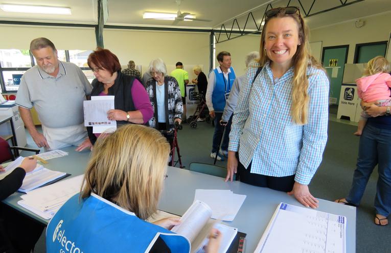 Georgina Cunich receives her ballot paper in Bulahdelah.