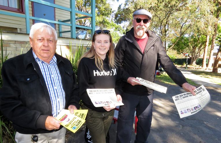 Eric Saville, Holly Ekert and Peter Aulbury distribute how to vote cards in Bulahdelah.