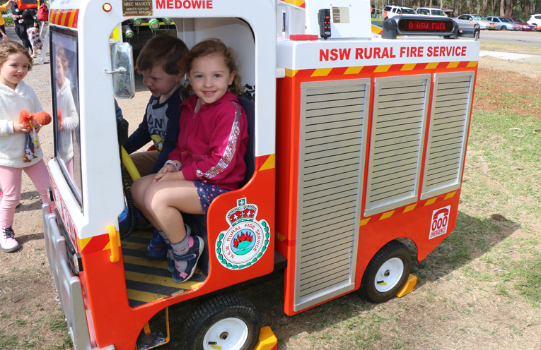 Archie and Ellie Green trying out 'Mike' the fire truck, made by Fire brigade volunteer Bill Taylor.