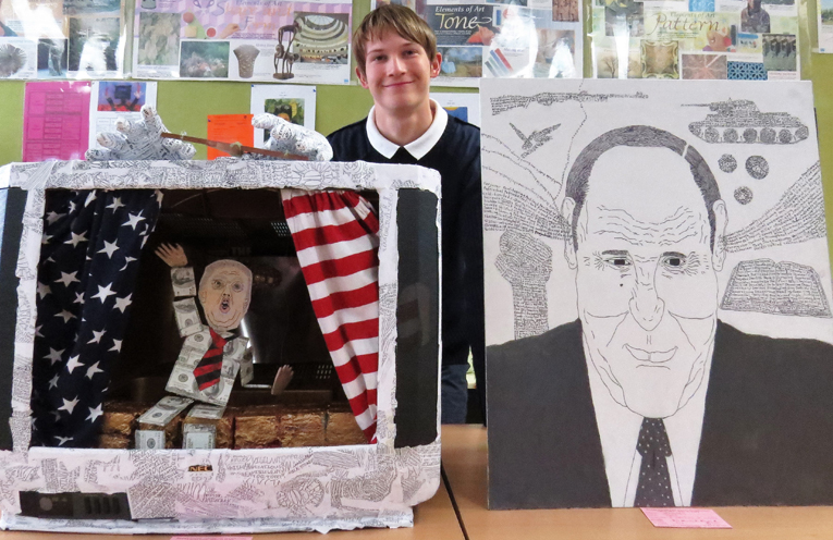 Darcy Harris with his political sculpture and caricature portrait.