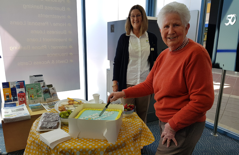 50th ANNIVERSARY: Member Ann Browning cuts the cake.