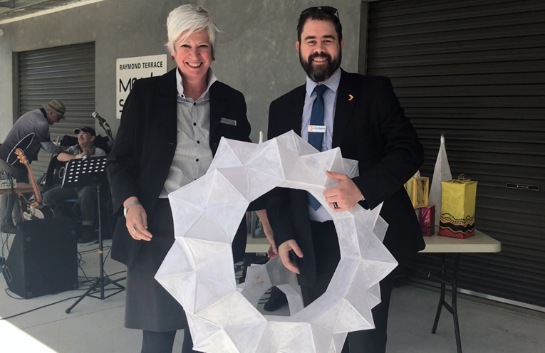 Penny Amberg, Council's Integrated Strategic Planning Manager, at the festival launch with Greater Bank's Chris Baguley receiving a sponsorship lantern hanging which is now hanging in one of the Port Stephens Greater Bank Branches.