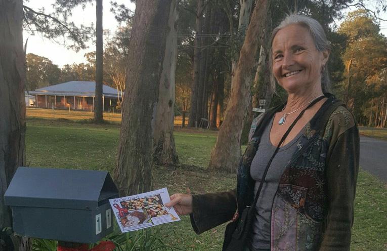 Julie Hawkins, delivering flyers to residents.