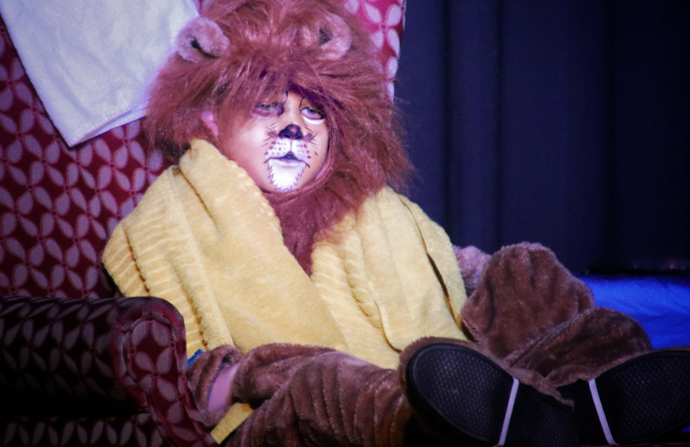 Charlie McGrath as the Vegetarian Lion.