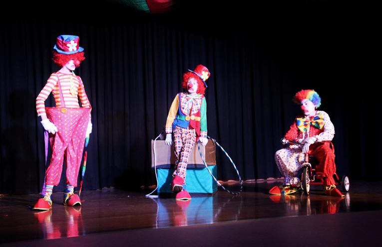 Clowns on stage Rowan Connick, Joshua Carpenter and Benjamin Carpenter.