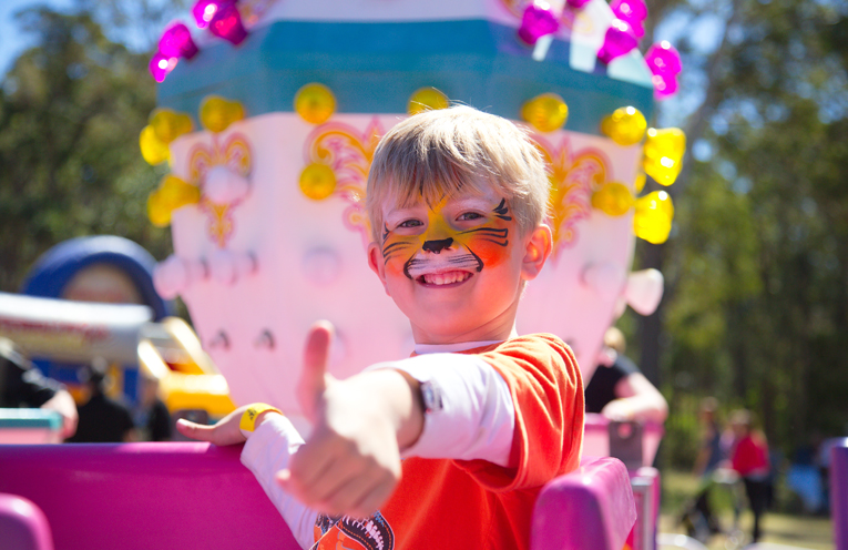 A little Tiger having fun on the teacup ride. Photo by Pete Neville