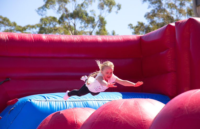 Scarlett Lewis on the bouncing pillow in the jumping castle. Photo by Pete Neville