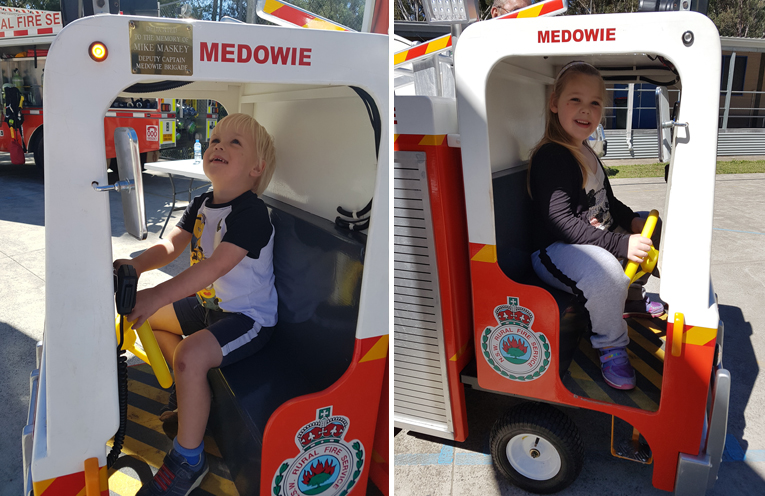 Oscar, 3 years old, is very excited about the Fire Brigade's replica fire truck. (left) Hunter, 6 years old learning about Mike the replica fire truck. (right)