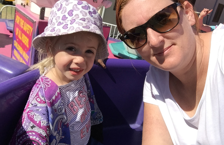 Cat Kelly and her three year old daughter having fun on the teacups.