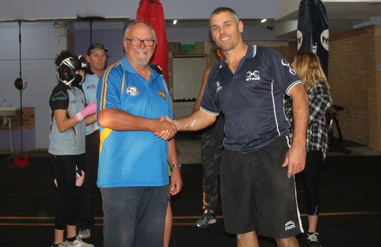 PCYC DONATION: Ulysses Club President David Cant with PCYC's Senior Constable Rob Wylie.