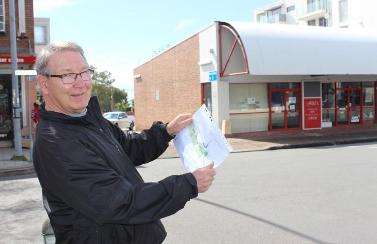 Peter Clough with an artist's impression of the road link.