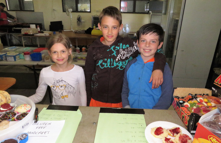 Service With A Smile: Salome Rietsma, Nathaniel Rietsma and Aiden Miles serve in the canteen.