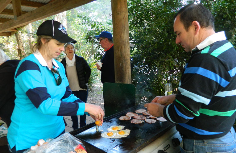 Rebecca and Rod cooking breakfast.