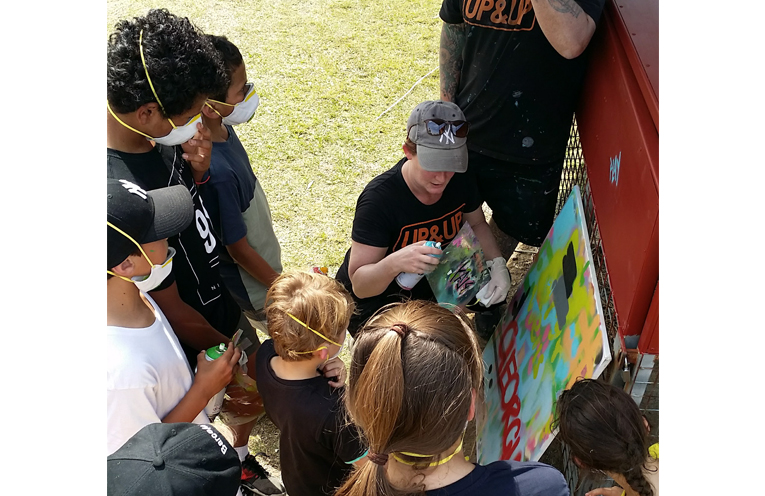 UP&UP Artists Shane Kennedy and Faye Curtis with some Medowie young people who helped with the artwork.