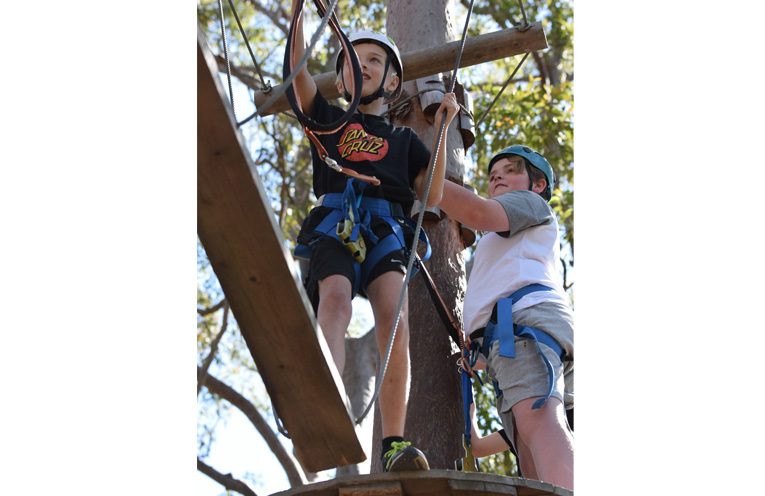 Jimmy Pitcher and Joshua Guthrie exploring the high ropes.
