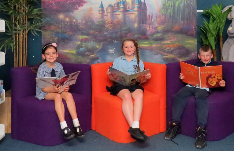 Scarlet Ray, Nikita Wheaton and Isaac Redman enjoy a book in the reading corner.