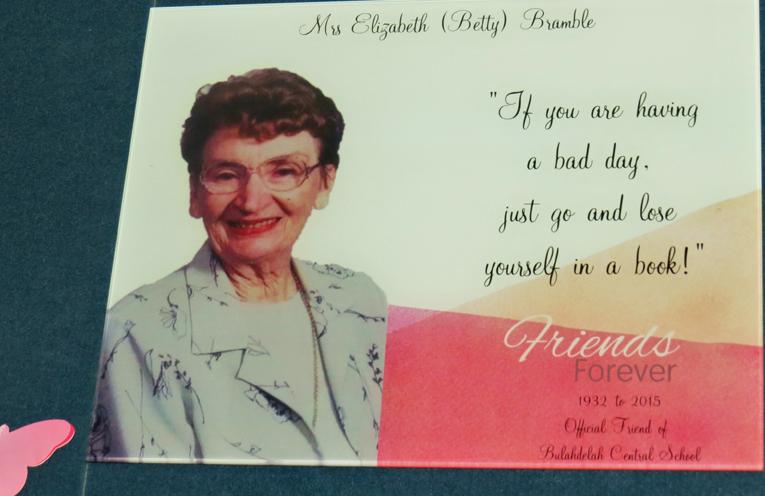 A plaque honours Mrs Bramble's devotion to education.