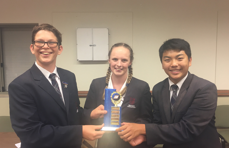 William Poley, Kimberley Osborne and Brian Tang with their COWs trophy.