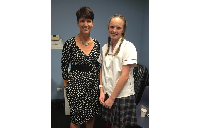 Kimberley Osborne sharing the details of the competition and win with MP Kate Washington.