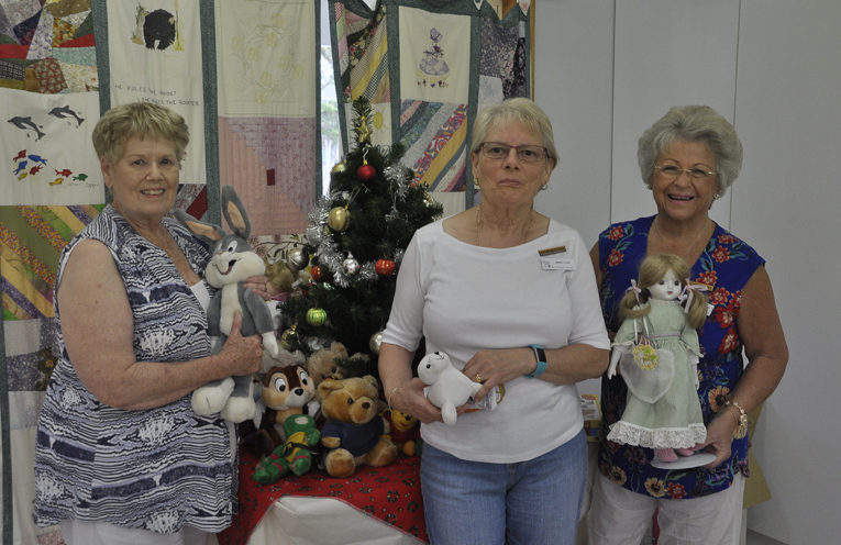 SALVATION ARMY CHRISTMAS APPEAL: Annette Naylor, Jenny Love and Di Taylor admiring gifts.