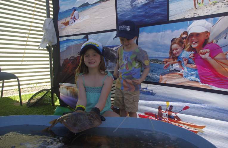 Charlotte and Haydon Drake with a Banjo Shark at the touch pool at Gone Fishing Nelson Bay. Photo by Marian Sampson