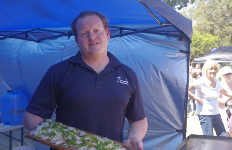 Chef Ben Way serving up Huon Aquaculture's locally grown sustainable Kingfish Sashimi. Photo by Marian Sampson