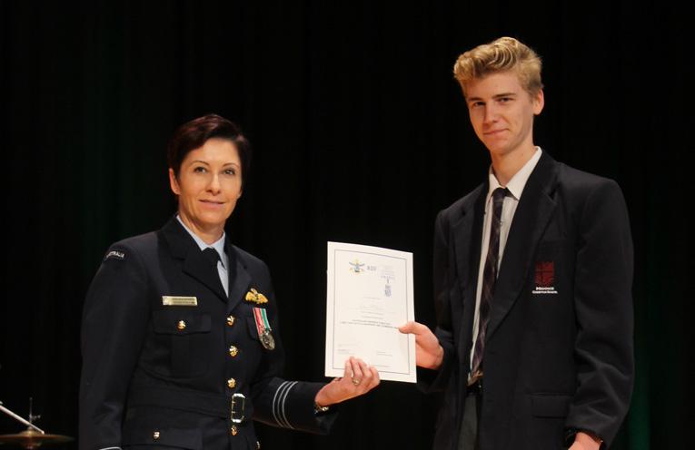 Joshua Archer receiving the Long Tan Award from SQL Vicki Bezuidenhout.