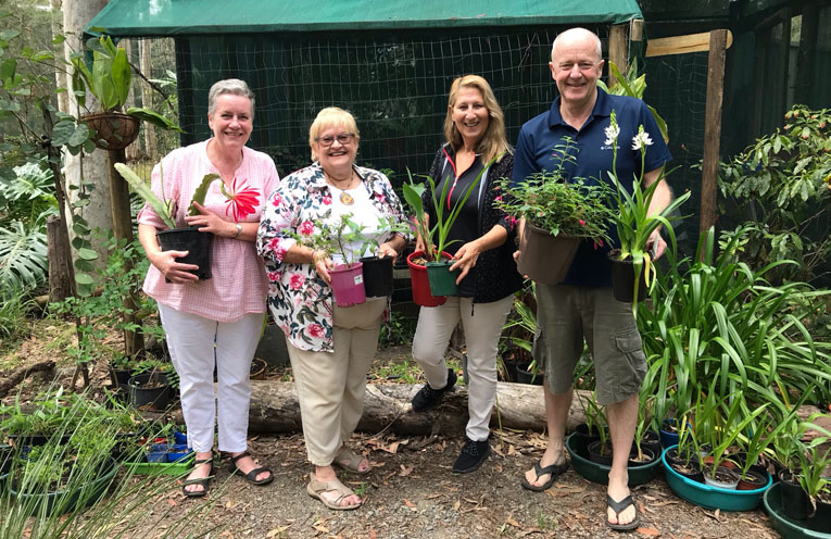 Green thumbs a plenty with Medowie Garden Club members preparing for the plant sale.