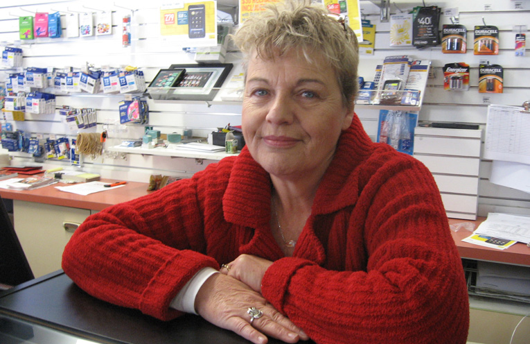 Newsagent Julie Fitzgerald with that winning smile.