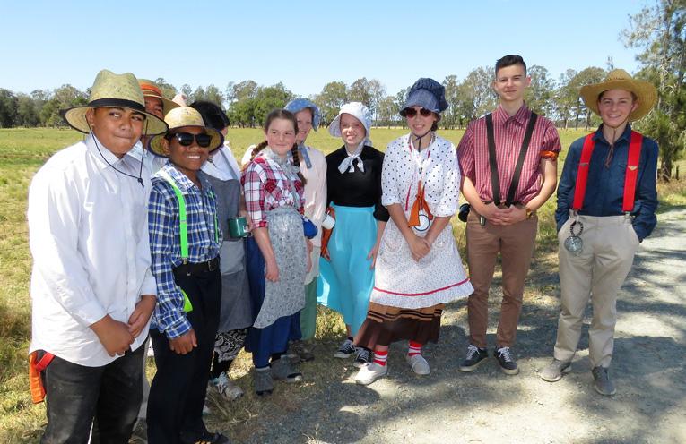 Teens dressed in pioneer clothing for the Bulahdelah trek.