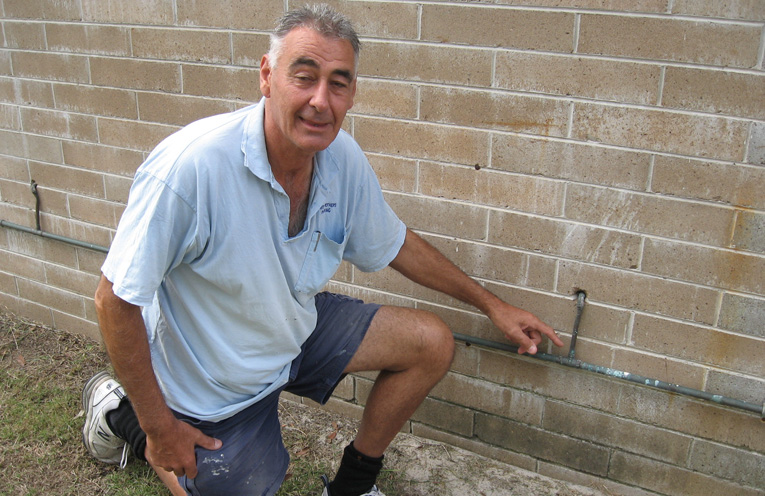 Geoff inspecting the pipes.