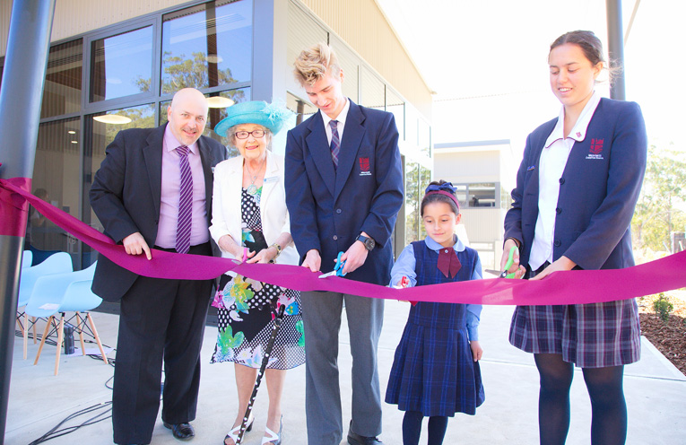 The official ribbon cutting by Mr Simon Herd, Mrs Maureen (Nanna) Cole, Tiarna Bezuidenhout (kinder student), Joshua Archer and Kathleen Churchill (school captains) Photos by Pete Neville