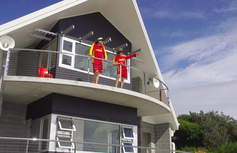 Australian Lifeguard Services Danny and Joe on duty at the new facility at One Mile Beach using the helpful elevation to keep an eye on people. Photo by Marian Sampson.