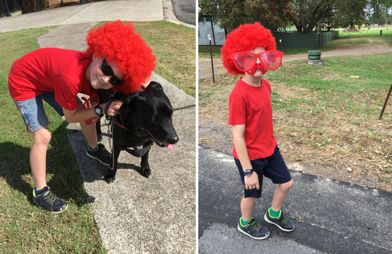 Jackson in his new trademark red wig, with his Uncle Lindsay's dog, Max. (left) Keep an eye out for Jackson's colourful outfit around the streets as he raises funds for Heart Disease research. (right)